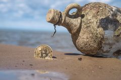 bitcoin on the beach Royalty Free Stock Image