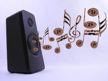 Bitcoin beat box. Speaker where the music coming out sounds like cashing in Bitcoins Royalty Free Stock Photos