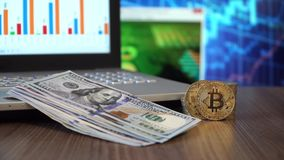 Bitcoin and Dollars stock footage