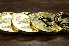 Bitcoin. In a row of 1 ounce American gold eagle bullion coins royalty free stock photography