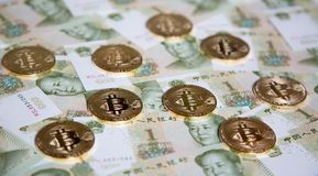 Bitcoin. S over the background made of Chinese yuan royalty free stock images