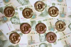 Bitcoin. S over the background made of Chinese yuan royalty free stock photography