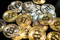 Bitcoin with a black background royalty free stock image