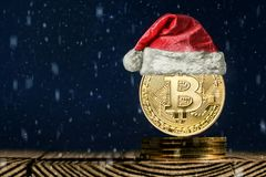 A bitcoin on the christmas backgrounds stock images