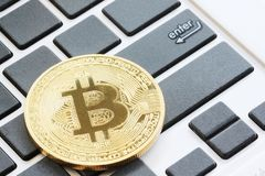 bitcoin on black keyboard concept stock image