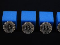 Bitcoin block chain. Bitcoins and blue blocks on dark background as a representation of the block chain Stock Photography