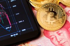 Bitcoin Blockchain concept Online banking and trading close up renminbi yuan bitcoin china. Trading graph cryptocurrency mobile royalty free stock photography