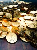 Bitcoin boom, stack of golden coins. Scattered on table, 3D illustration Stock Photography