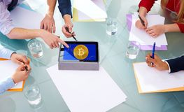 Bitcoin BTC business meeting with hands pointing. To cryptocurrency Royalty Free Stock Photo