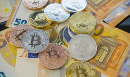 Bitcoin BTC coins on bills of euro banknotes. Worldwide virtual Royalty Free Stock Photography