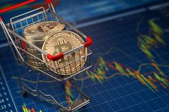 Bitcoin BTC coins in the shopping cart on the financial diagram. Cryptocurrency market concept. 3d illustration Stock Photo