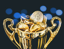 Bitcoin BTC coins on trophy. On stock images