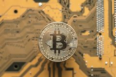 Bitcoin. btc. Crypto currency bitcoin. Bitcoin coin on exchange charts. e-currency bitcoin on the blur background of the circuit board royalty free stock images
