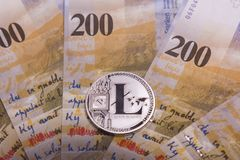 Bitcoin crypto currency coin over swiss francs bank notes Stock Photo