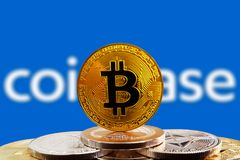 Bitcoin BTC on cryptocurrency with Coinbase logo background. Bitcoin BTC on stack of cryptocurrencies with Coinbase logo in background. The cryptocurrency coin stock photos