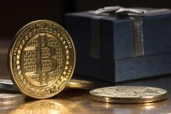 Bitcoin btc cryptocurrency and gift box btc golden coin as symbol of electronic virtual.  Royalty Free Stock Photography