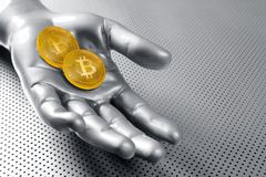 Bitcoin BTC cryptocurrency on silver hand. Bitcoin BTC cryptocurrency on silver futuristic hand Stock Photo