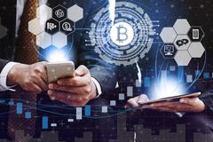 Bitcoin BTC and Cryptocurrency Trading Concept. Bitcoin and cryptocurrency investing concept - Businessman using mobile phone application to trade Bitcoin BTC stock photography