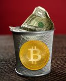Bitcoin BTC on the dollar trash negative concept. Bitcoin BTC on the dollar trash cryptocurrency negative concept Stock Photos