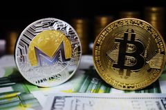 Bitcoin BTC and Monero XRM coin on banknotes, against the background of money growing stairs. Golden Bitcoin BTC and Monero XRM coin on background growing money royalty free stock photo