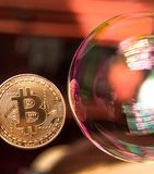 Bitcoin and the bubble as an abstract symbol of the risks of a digital currency and possible collapse and abrupt change of course. Falling, collapse, fiasco royalty free stock photo