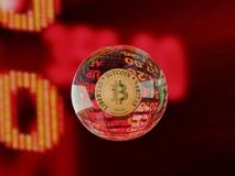 Bitcoin Bubble cryptocurrency. A bubble bitcoin cryptocurrency floating over a crashing stock exchange market stock image