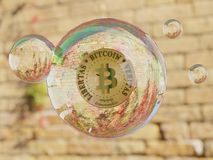 Bitcoin Bubble Cryptocurrency. A bitcoin cryptocurrency within a bubble is ready to burst stock images