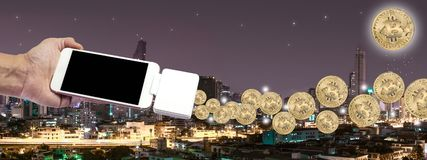 Bitcoin with Building in Bangkok at night time. Concept business about electronic money for future Royalty Free Stock Images