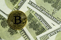 Bitcoin, calculator and dollars calculations of the new cryptocurrency. Bitcoin, dollars calculations of the new cryptocurrency Royalty Free Stock Image