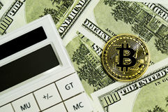 Bitcoin, calculator and dollars calculations of the new cryptocurrency. Bitcoin, dollars calculations of the new cryptocurrency Stock Photography