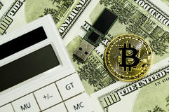 Bitcoin, calculator and dollars calculations of the new cryptocurrency. Bitcoin, dollars calculations of the new cryptocurrency Royalty Free Stock Images