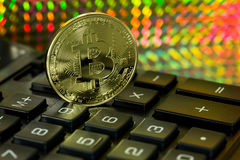 Bitcoin and calculator Royalty Free Stock Images