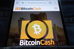 Bitcoin Cash cryptocurrency website displayed on smartphone hidden in jeans pocket. KONSKIE, POLAND - JUNE 02, 2018: Bitcoin Cash cryptocurrency website royalty free stock images