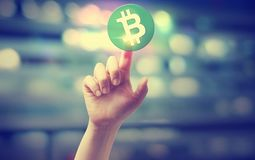 Bitcoin Cash with hand pressing a button. On blurred abstract background Stock Image
