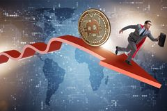 The bitcoin chasing businessman in cryptocurrency price crash. Bitcoin chasing businessman in cryptocurrency price crash stock photo