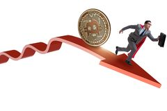 The bitcoin chasing businessman in cryptocurrency price crash. Bitcoin chasing businessman in cryptocurrency price crash royalty free stock image