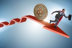 The bitcoin chasing businessman in cryptocurrency price crash. Bitcoin chasing businessman in cryptocurrency price crash royalty free stock images