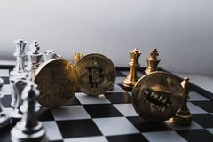 Bitcoin on chess board game of business ideas stock images