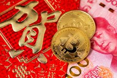 Bitcoin Chinese new year concept. Chinese New Year Cocept Red Envelope RMB Renminbi. Bitcoin Chinese new year concept year of pig Bitcoin RMB Renminbi Yuan Pig stock photo