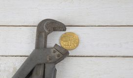 Bitcoin in the clamp. Risk of economic crisis. The fall of the currency. On a white background.  Stock Image