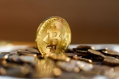 Bitcoin closeup shimmers in gold in the sun. Coins. Finances royalty free stock image