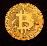 Bitcoin coin asphalt background studio Stock Photography