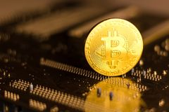 Bitcoin coin on the back of a pc motherboard. royalty free stock photos