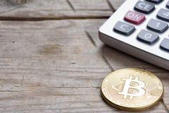 Bitcoin coin and calculator Stock Photos