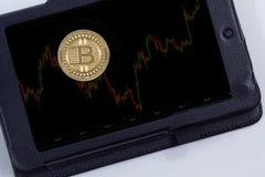 Bitcoin coin chart. Bitcoin gold coin chart on tablet Stock Photos