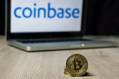 Bitcoin coin with the Coinbase exchange logo on a laptop screen, Slovenia - December 23th, 2018 royalty free stock image