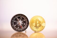 Bitcoin coin and compass. royalty free stock image