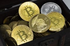 Bitcoin coin crypto finance business dark ramdom. Nice bitcoin coins in wood chest close up Royalty Free Stock Images