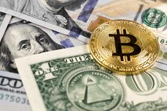 Bitcoin coin on dollars Royalty Free Stock Image