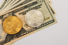 Bitcoin coin with dollars. On the laptop background Stock Images
